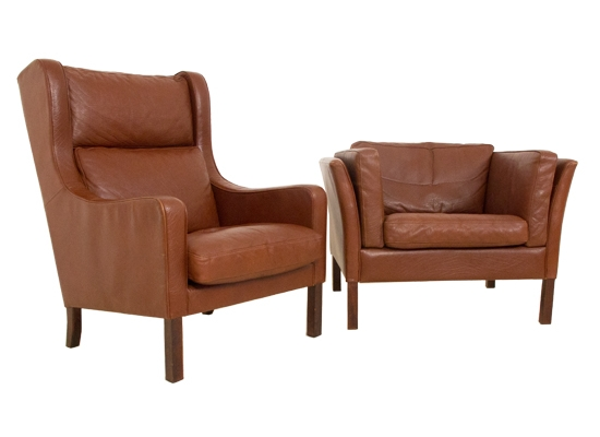 a pair of danish lounge chairs